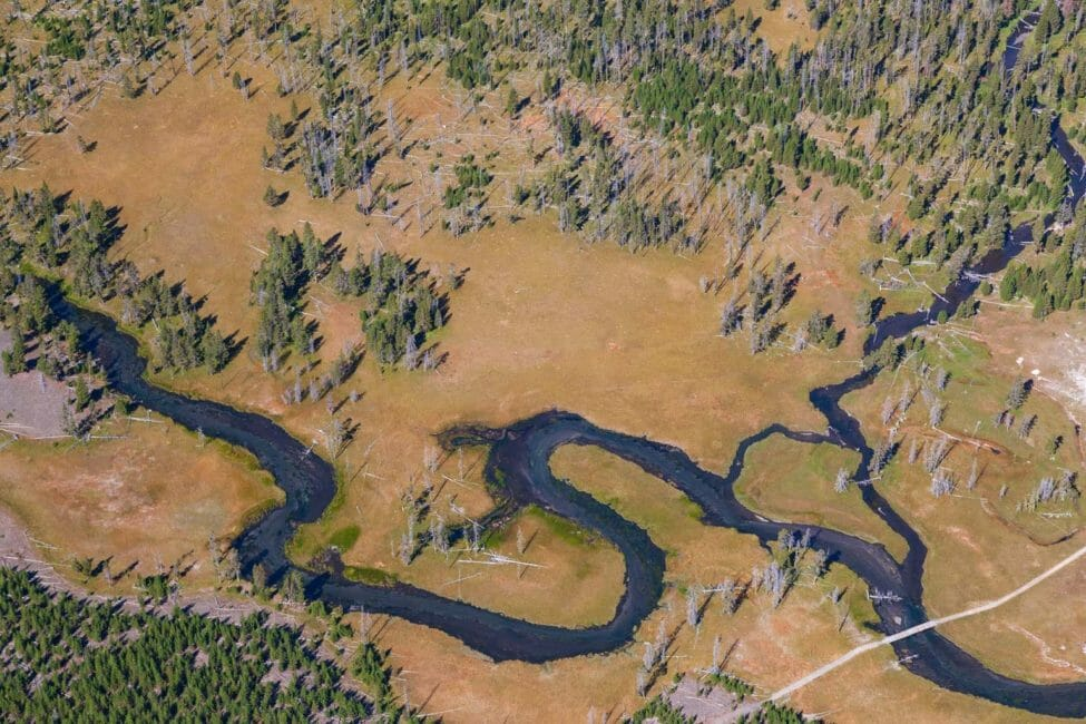 An Aerial Photograph of A Meandering Creek Is Visible In Yellowstone's Pelican Valley