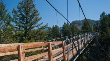 A Wooden Suspension Bridge Allows Hikers To Cross A Ravine At Hellroaring Falls in Yellowstone National Park